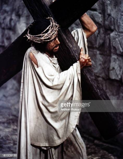 Max Von Sydow carries a cross in a scene from the film 'The Greatest Story Ever Told' 1965