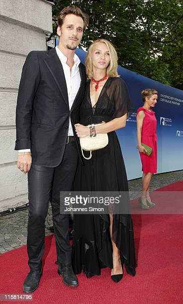 Max von Thun and girlfriend Kim Eberle arrive for the Bavarian TV Award 2011 'Der Blaue Panther' at Prinzregententheater theatre on June 10 2011 in...