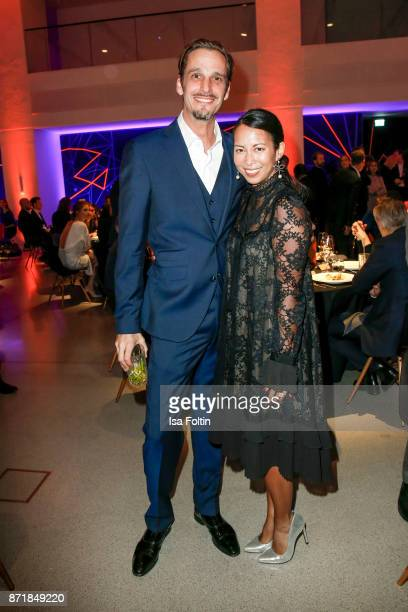 Max von Thun and MinhKhai PhanThi attend the Volkswagen Dinner Night prior to the GQ Men of the Year Award 2017 on November 8 2017 in Berlin Germany