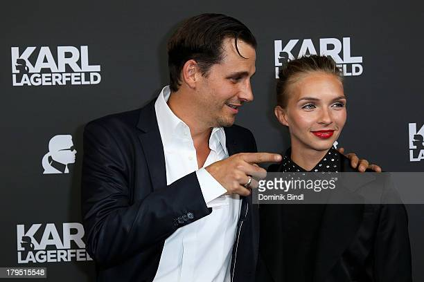 Max von Thun Hohenstein and Kim Eberle attend the Karl Lagerfeld store opening on September 4 2013 in Munich Germany