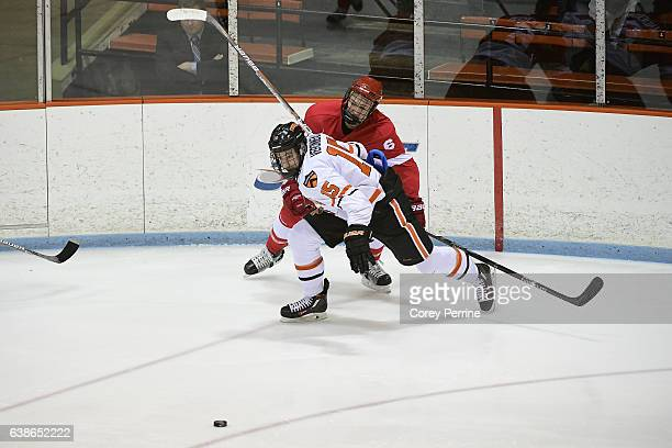 Max Véronneau of the Princeton Tigers eyes the puck Holden Anderson of the Cornell Big Red during the first period at Hobey Baker Rink on January 13...