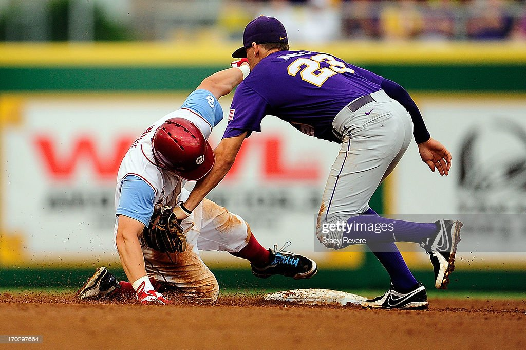 Max White #7 of the Oklahoma Sooners is tagged out at second base by JaCoby Jones #23 of the LSU Tigers during Game 2 of the NCAA baseball Super Regionals at Alex Box Stadium on June 8, 2013 in Baton Rouge, Louisiana.