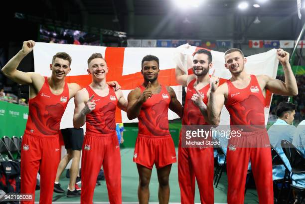 Max Whitlock, Nile Wilson, Courtney Tulloch, James Hall and Dominick Cunningham of England celebrate winning gold in the Men's Team Final and...
