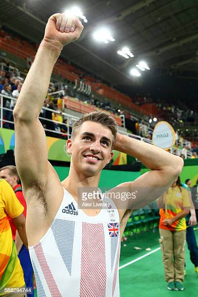 Max Whitlock of Great Britain celebrates winning the bronze medal after the Men's Individual AllAround final on Day 5 of the Rio 2016 Olympic Games...