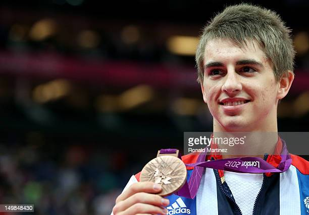 Max Whitlock of Great Britain celebrates with his bronze medal during the medal ceremony following the Artistic Gymnastics Men's Pommel Horse final...