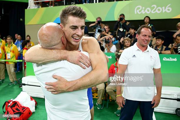 Max Whitlock of Great Britain is embraced by his coaching staff after winning the bronze medal after the Men's Individual AllAround final on Day 5 of...