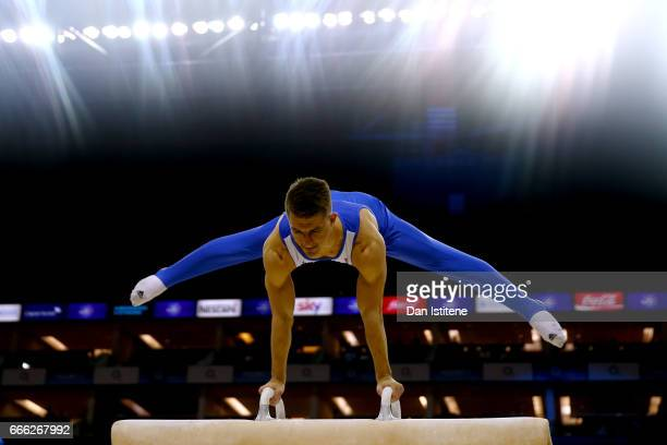 Max Whitlock of Great Britain performs a routine on the pommel horse during a break in the men's competition for the iPro Sport World Cup of...