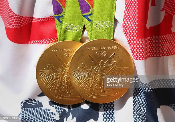 Max Whitlock of Great Britain poses for photographs with his two gold medals in front of the Olympic Park on day 10 on August 15 2016 in Rio de...