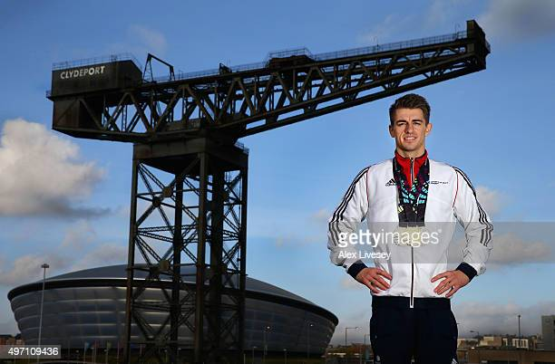 Max Whitlock of the British Gymnastics team poses for a portrait with his Gold and Silver medals won at the 2015 World Artistic Gymnastics...