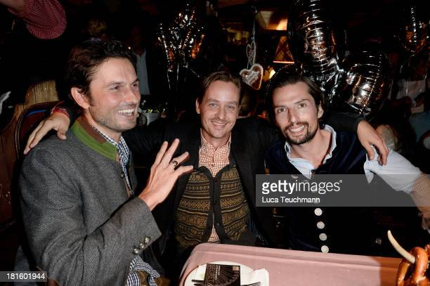 Max Wiedemann Tom Schilling and Quirin Berg attend the 'Almauftrieb' as part of the Oktoberfest beer festival at Kaefer tent at Theresienwiese on...