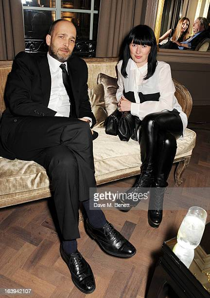 Max Wigram and Charlotte Cutler attend a party celebrating Patrick Cox's 50th Birthday party at Cafe Royal on March 15 2013 in London England