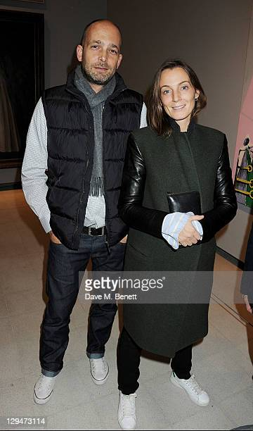 Max Wigram and Phoebe Philo attend a private view of American artist George Condo's first retrospective exhibit 'George Condo Mental States' at The...