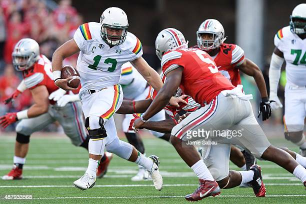 Max Wittek of the Hawaii Rainbow Warriors looks to elude the defense of Raekwon McMillan of the Ohio State Buckeyes in the third quarter at Ohio...