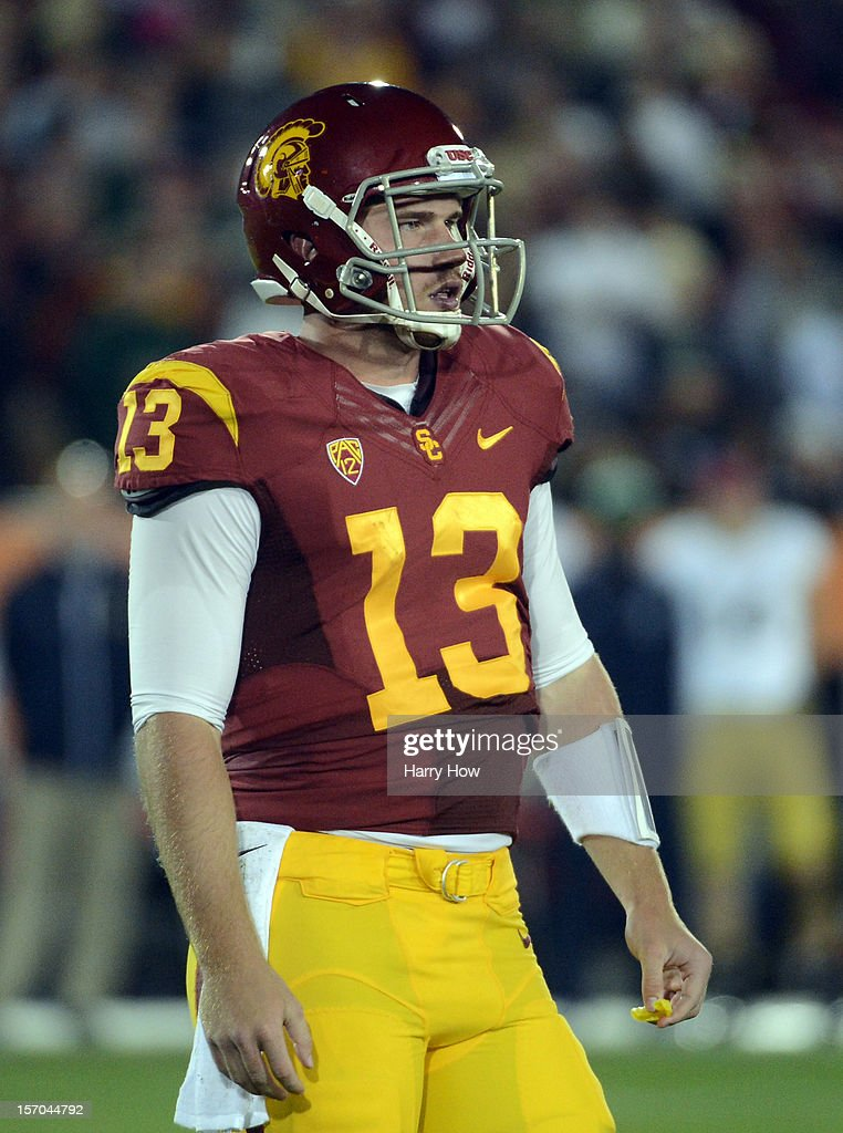 Max Wittek #13 of the USC Trojans looks for a play from the bench during a 22-13 loss to the Notre Dame Fighting Irish at Los Angeles Memorial Coliseum on November 24, 2012 in Los Angeles, California.