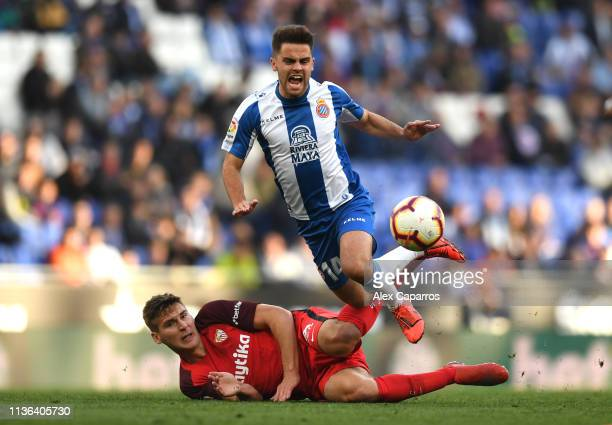 Max Wober of Sevilla tackles Oscar Melendo of Espanyol during the La Liga match between RCD Espanyol and Sevilla FC at RCDE Stadium on March 17, 2019...