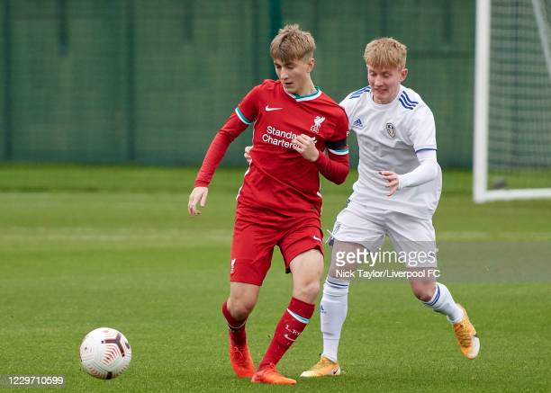 Max Woltman of Liverpool and Alfie Hughes of Leeds United in action at Melwood Training Ground on November 21, 2020 in Liverpool, England.