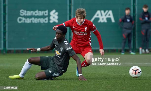 Max Woltman of Liverpool and Bjorn Hardley of Manchester United in action during the U18 Premier League game between Liverpool and Manchester United...
