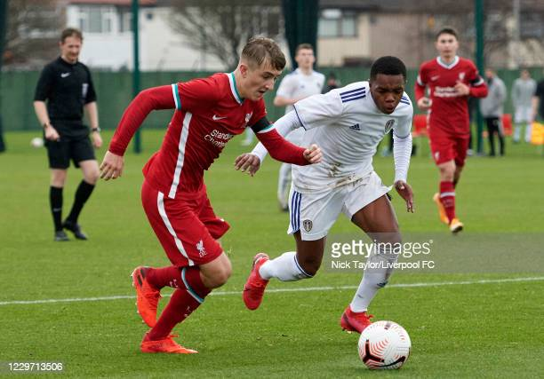 Max Woltman of Liverpool and Ethan Kachosa of Leeds United in action at Melwood Training Ground on November 21, 2020 in Liverpool, England.