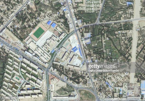 Maxar satellite imagery of a reeducation internment camp in Hotan Xinjiang China for the purpose of indoctrinating Uyghurs since 2017 Please use...