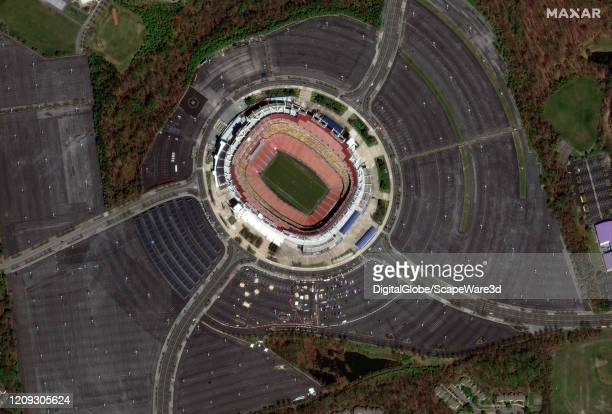 Maxar satellite imagery of the coronavirus testing at FedEx Field in Baltimore Maryland during the COVID19 pandemic Please use Satellite image 2020...