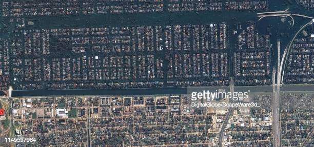 Maxar satellite imagery of the levee break at Bellaire Drive in West New Orleans Please use Satellite image 2019 Maxar Technologies