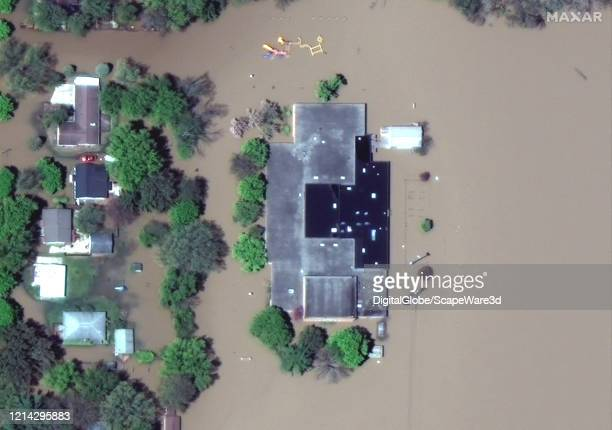 Maxar satellite imagery of Windover High School in west Midland Michigan due to the Tittabawassee River flooding Please use Satellite image 2020...