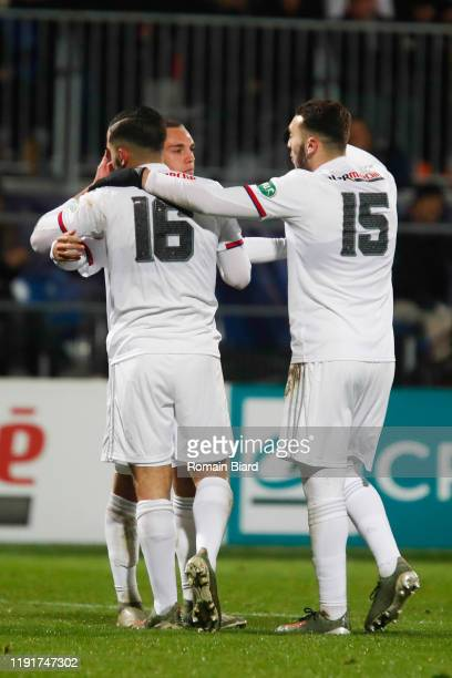 Maxence CAQUERET of Lyon and Ryann CHERKI of Lyon and Amine GOUIRI of Lyon during the French Cup match between Bourg en Bresse and Lyon on January 4,...