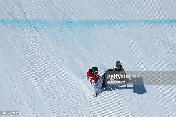 Maxence Parrot of Canada crashes in his first run during the Snowboard Men's Slopestyle Final during day 1 of the Sochi 2014 Winter Olympics at Rosa...