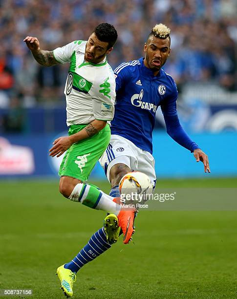 Maxi Choupo Moting of Schalke challenges Vieirinha of Wolfsburg during the Bundesliga match between FC Schalke 04 and VfL Wolfsburg at VeltinsArena...