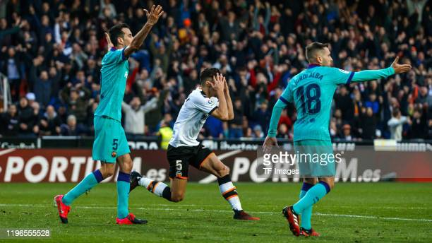 Maxi Gómez of FC Valencia and Ter Stegen of FC Barcelona controls the ball during the La Liga Santander match between Valencia v FC Barcelona at the...