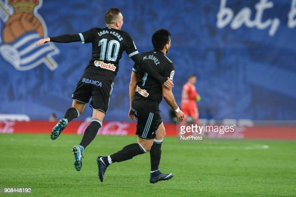 Maxi Gomez of Celta celebrates his goal after scoring against Iago Aspas during the Spanish league football match between Real Sociedad and Celta at...