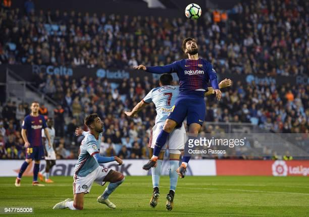 Maxi Gomez of Celta de Vigo competes fo the ball with Andre Gomes of Barcelona during the La Liga match between Celta de Vigo and Barcelona at...