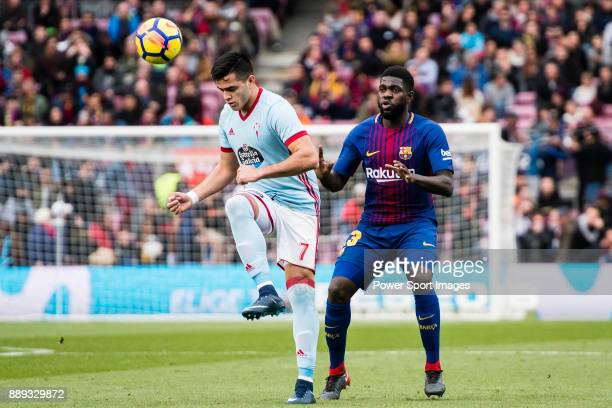 Maxi Gomez of RC Celta de Vigo fights for the ball with Samuel Umtiti of FC Barcelona during the La Liga 201718 match between FC Barcelona and RC...
