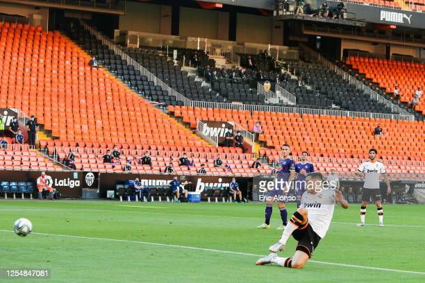 Maxi Gomez of Valencia CF scores his team's first goal during the Liga match between Valencia CF and Real Valladolid CF at Estadio Mestalla on July...