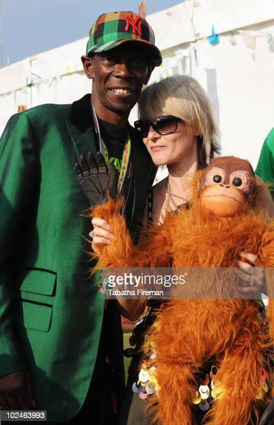 Maxi Jazz and Sister Bliss of Faithless attend the backstage hospitality area on the final day of Glastonbury Festival holding an orangutang to...
