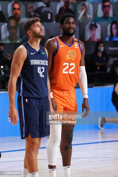 Maxi Kleber of the Dallas Mavericks and Deandre Ayton of the Phoenix Suns looks on during the game on August 13 2020 at AdventHealth Arena in Orlando...