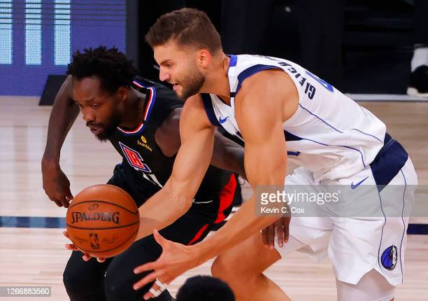 Maxi Kleber of the Dallas Mavericks grabs a loose ball against Patrick Beverley of the LA Clippers during the third quarter in Game One of the...
