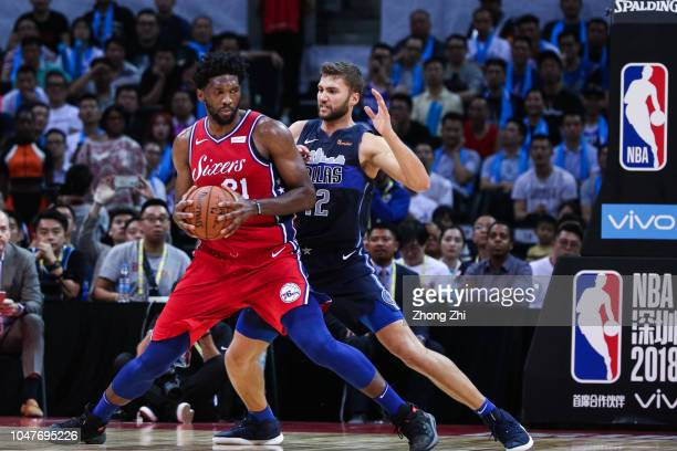 Maxi Kleber of the Dallas Mavericks in action against Joel Embiid of the Philadelphia 76ers during the 2018 NBA China Games match between the Dallas...