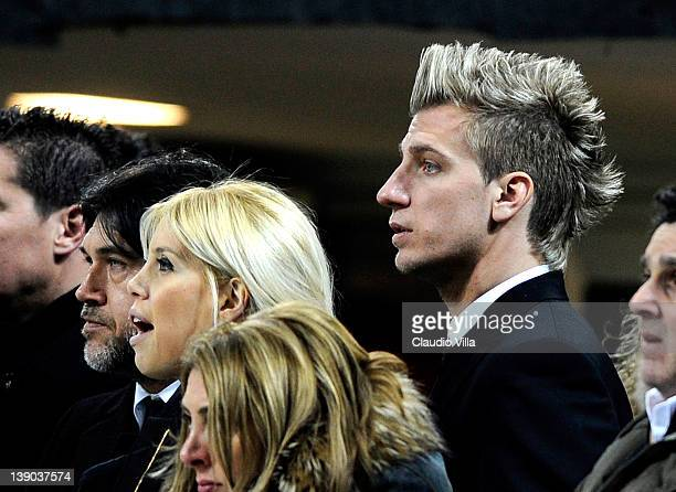 Maxi Lopez of AC Milan and his wife Wanda Naraduring the UEFA Champions League round of 16 first leg match between AC Milan and Arsenal FC at Stadio...
