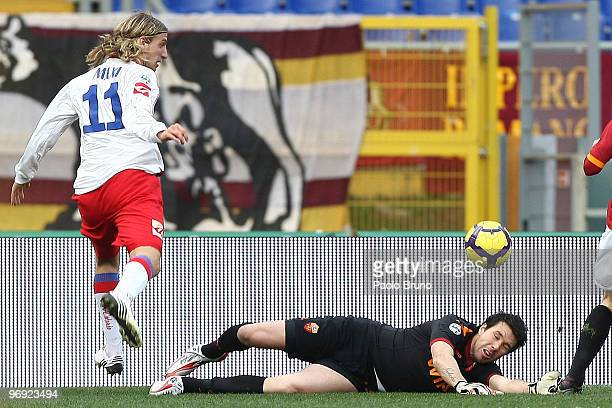Maxi Lopez of Catania Calcio and Alexander Doni the goalkeeper of AS Roma compete for the ball during the Serie A match between AS Roma and Catania...