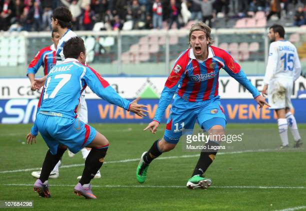 Maxi Lopez of Catania celebrates his opening goal with team-mate Alejandro Gomez during the Serie A match between Catania and Brescia at Stadio...