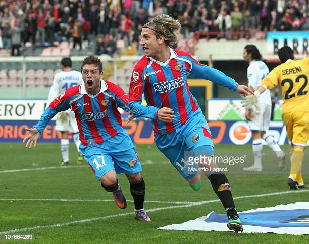 Maxi Lopez of Catania celebrates with team-mate Alejandro Gomez afer scoring the opening goal of the Serie A match between Catania and Brescia at...