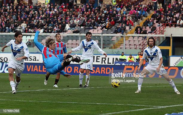 Maxi Lopez of Catania scores the opening goal of the Serie A match between Catania and Brescia at Stadio Angelo Massimino on December 19, 2010 in...