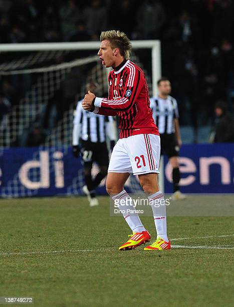 Maxi Lopez of Milan celebrates after scoring his team's first goal during the serie A match between Udinese Calcio and AC Milan at Stadio Friuli on...