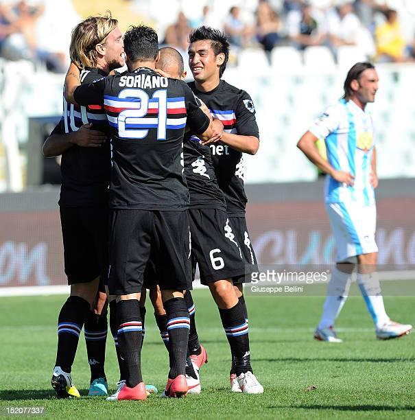 Maxi Lopez of Sampdoria celebrates with teammates after scoring the opening goal during the Serie A match between Pescara and UC Sampdoria at...