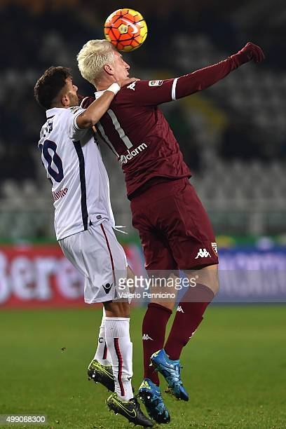 Maxi Lopez of Torino FC is challenged by Domenico Maietta of Bologna FC during the Serie A match between Torino FC and Bologna FC at Stadio Olimpico...