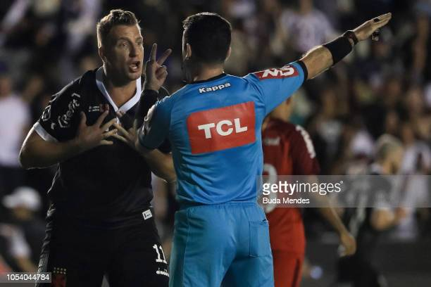 Maxi Lopez of Vasco da Gama reacts with the referee during a match between Vasco da Gama and Internacional as part of Brasileirao Series A 2018 at...