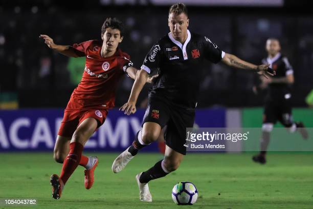 Maxi Lopez of Vasco da Gama struggles for the ball with Rodrigo Dourado of Internacional during a match between Vasco da Gama and Internacional as...