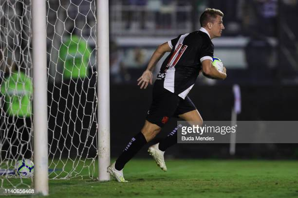 Maxi Lopez of Vasco da Gama takes the ball as he celebrates after scoring the equalizer during a match between Vasco da Gama and Atletico Mineiro as...