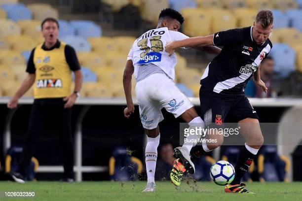 Maxi López of Vasco da Gama struggles for the ball with Robson Bambu of Santos during a match between Vasco da Gama and Santos as part of Brasileirao...